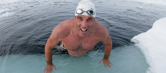 Lewis Pugh swam across an open patch of sea at the North Pole to highlight the melting of the Arctic sea ice