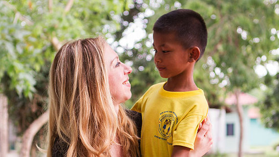 While visiting Clinton Health Access Initiative projects in Cambodia, Chelsea Clinton meets Basil, who was one of the first children to receive pediatric antiretroviral treatment in the country.