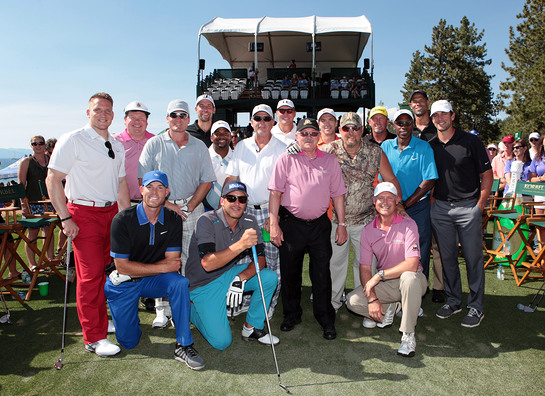 Sports and entertainment superstars pose with Korbel California Champagne owner and president Gary Heck during the second annual Korbel Celebrity Hole-In-One contest in Lake Tahoe