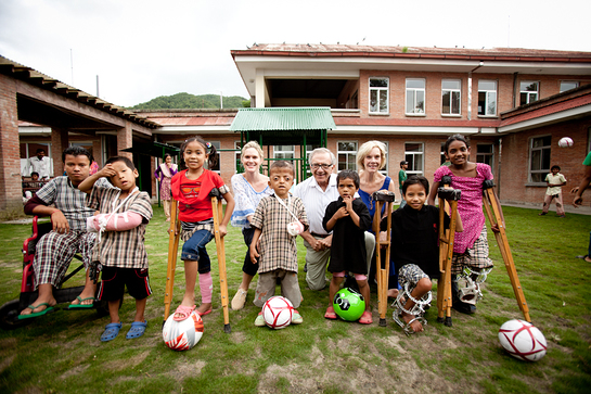 Stephanie March and World of Children Award Co-founders Harry Leibowitz and Kay Isaacson-Leibowitz with group of children at the Hospital and Rehabilitation Centre for Disabled Children in Nepal