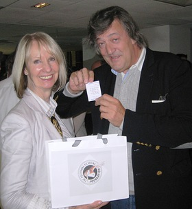 Stephen Fry and Pollyanna Pickering drawing the winning ticket