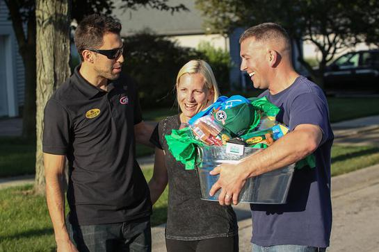 Eckrich and NASCAR driver Aric Almirola surprise active duty military member Howard Kott and his wife, Dawn, at their Ann Arbor home.