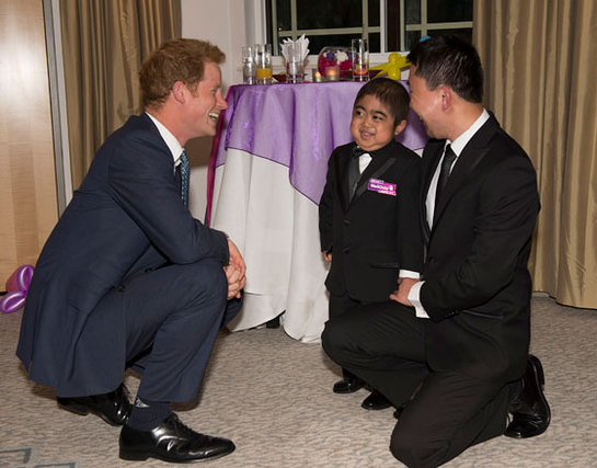 Prince Harry talks to Jonathan, aged six.