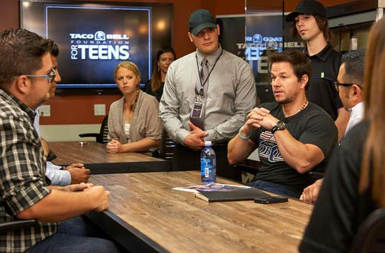 Mark Wahlberg shares his high school graduation story with Taco Bell employee online high school scholarship recipients at its Irvine, Calif. headquarters
