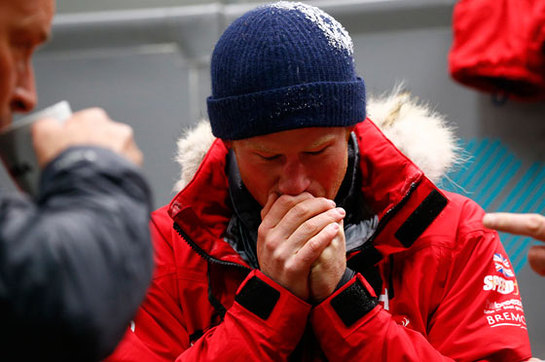 Prince Harry warms his hands after a cold chamber training exercise with the Walking with the Wounded South Pole Allied Challenge 2013 British team