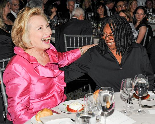 Former Secretary of State Hillary Rodham Clinton has a laugh with actor and television personality Whoopi Goldberg.