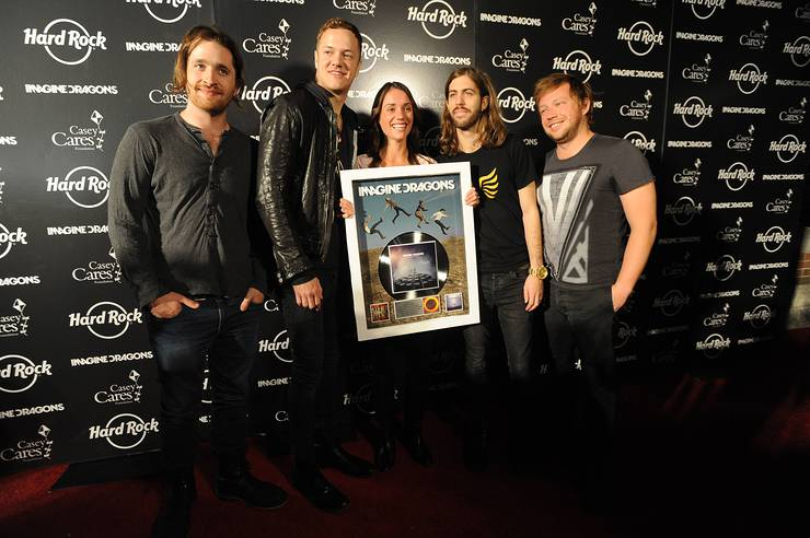 Imagine Dragons band members, left to right, Daniel Platzman, Dan Reynolds, Wayne Sermon and Ben Mckee are presented the RIAA Gold & Platinum career award by RIAA's Liz Kennedy