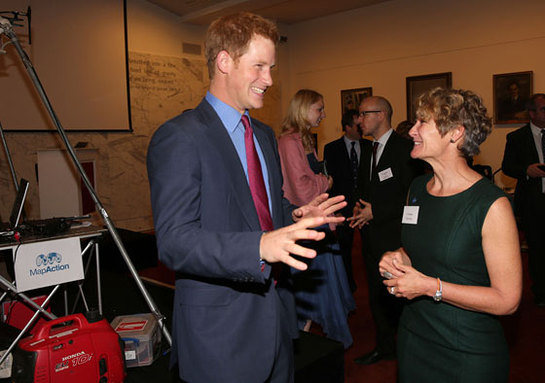 Prince Harry with Chief Executive Liz Hughes (right) at a reception for MapAction at the Royal Society, London.