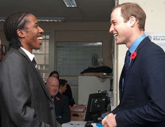 The Duke of Cambridge talks to Junior Smart the SOS Business Relationship Manager as he visits the head office of the St Giles Trust in Camberwell, London