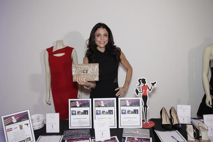 Bethenny Frankel proves that giving back is always in style as she donates three of her favorite clutches up for bidding at the Shop for Success VIP Party on Saturday, November 9, 2013 in New York City.
