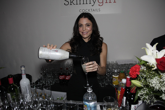 Guest mixologist Bethenny Frankel jumps behind the Skinnygirl® Cocktails bar at Dress for Success' Shop for Success VIP Party on Saturday, November 9, 2013 in New York City.