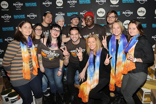 Lissie poses with Annie Balliro, Hard Rock's Senior Director of Brand Philanthropy, with WhyHunger representatives and Hard Rock Ambassadors