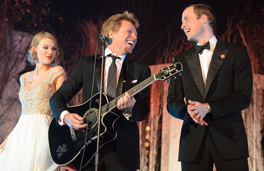 The Duke of Cambridge performs on stage with Bon Jovi and Taylor Swift