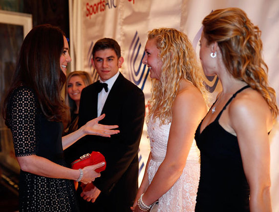 The Duchess of Cambridge meets British rower Jess Leyden, 18, (second right) as she attends the SportsAid SportsBall gala dinner