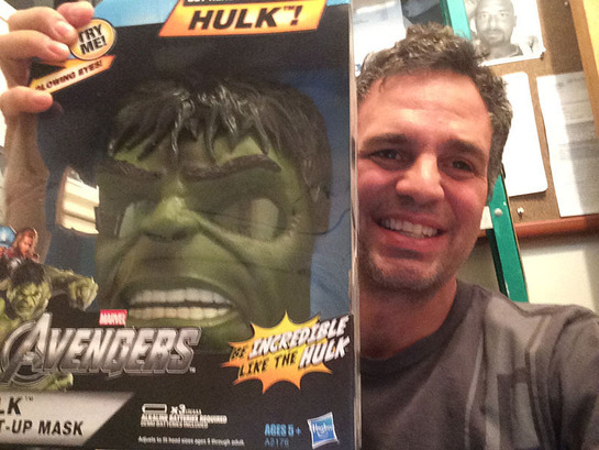 Mark Ruffalo holds a boxed Hulk mask that he will sign for one lucky winner in the online auction