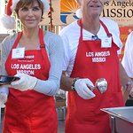 Stars Help Serve Meals To The Homeless On Christmas Eve