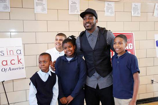 Hakeem Nicks with some of the students from PS 15 who participated in an afternoon of health education and physical fitness
