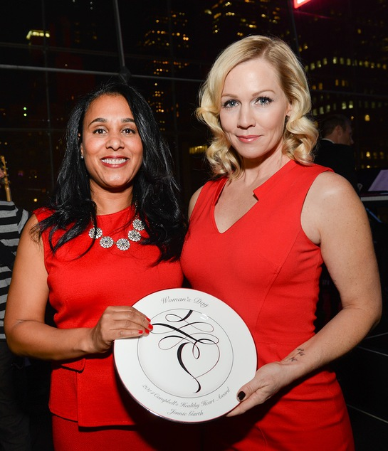 Jennie Garth, right, accepts the Campbell's Healthy Heart Award from Vice President - U.S. Soup for Campbell Soup Company, Leah Dunmore at the 2014 Woman's Day Red Dress Awards
