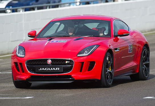 Prince Harry drives a Jaguar F-Type car as he attends The Royal Foundation Endeavour Fund track day at Goodwood Motor Circuit