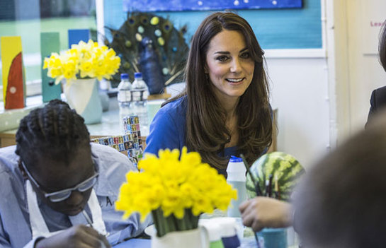 The Duchess of Cambridge talks to students at Northolt High School, London where she opened the The ICAP Art Room.