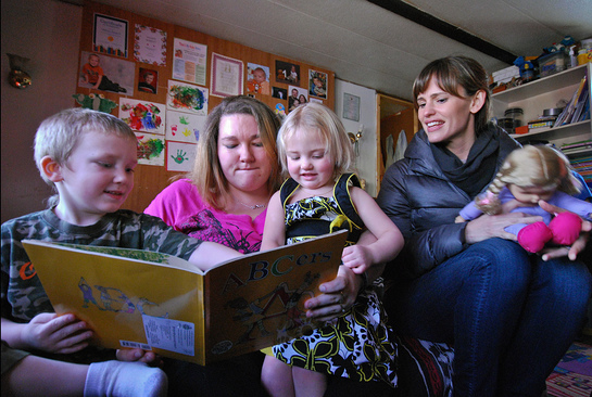 Save the Children Board of Trustees member Jen Garner visits with Lynmarie Sargent, 30, and her children at their home in Henderson, WV.