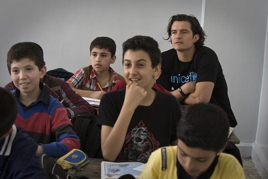 Orlando Bloom joins students during a Grade 6 English class, at Omar Bin Abdul Aziz Boys School in the northern city of Irbid, capital of Irbid Governorate