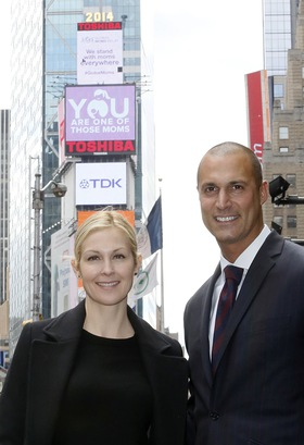 Kelly Rutherford and Nigel Barker stand in New York's Times Square before the new video for the Global Moms Relay,