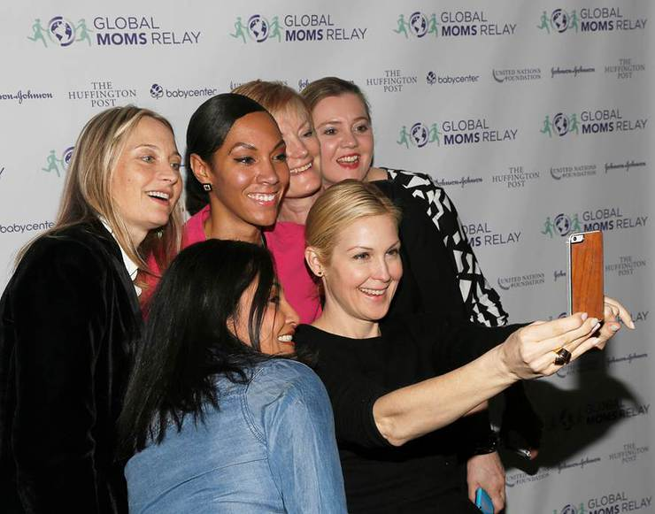 Kelly Rutherford takes a selfie with digital Moms during the premier of the new Global Moms Relay video
