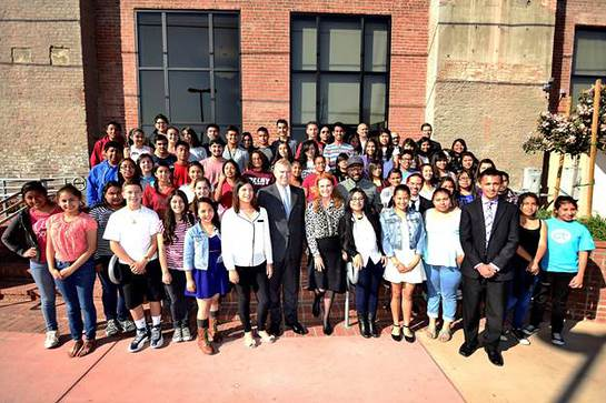 After a class assembly, The Duke of York, Sarah Ferguson, Duchess of Yorkand i.am.angel Foundation President, will.i.am, join students from the i.am College Track Boyle Heights program for a group photo.