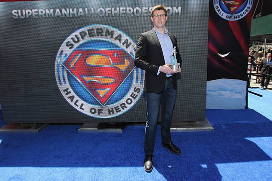 Matthew Reeve, eldest son of Christopher Reeve, accepts the Superman Hall of Heroes award on behalf of his father