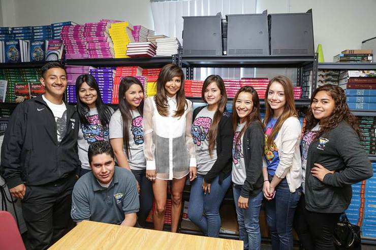 Naya Rivera posing with a group of students from Collins Family High School