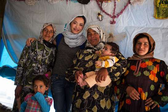Chinese actress Yao Shen meets Syrian refugees at a collective shelter in Tyre, Lebanon
