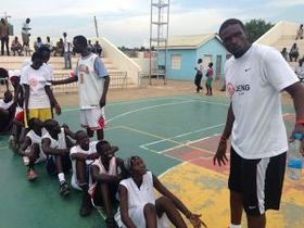 Luol Deng coaching kids at a basketball camp in Juba, South Sudan