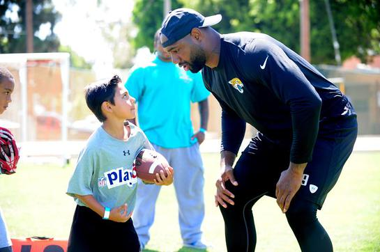 Marcedes Lewis and friend at the sixth annual Marcedes Lewis Foundation Football Camp