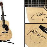 Paul Simon Signs Guitar With Dave Matthews And Aaron Neville For Auction