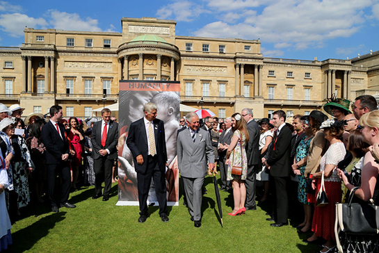 The Prince of Wales greets guests at the British Red Cross garden party