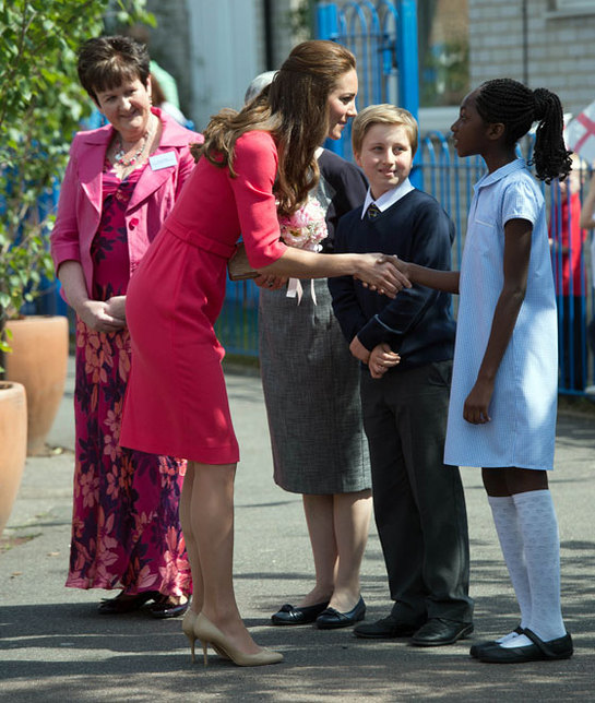 The Duchess of Cambridge speaks with children as she arrives at Blessed Sacrament School
