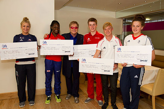 Elton John with the first SportsAid athletes to benefit from the Elton John Sports Fund