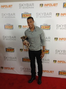 Dale Moss Holds Rescued Half Blind Yorkshire Terrier on Pre-Comic-Con Red Carpet in West Hollywood, Calif.
