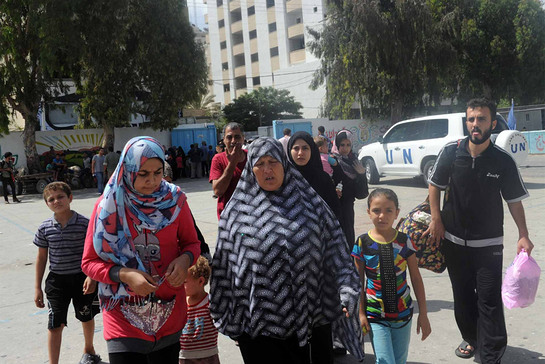 Palestinian families seek shelter at an UNRWA school after evacuating their homes north of the Gaza Strip