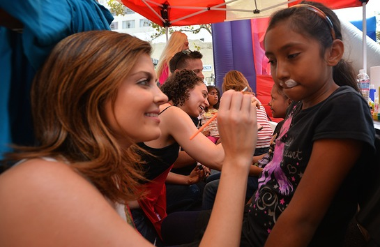 Jen Lilley paints children's faces as part of the Los Angeles Mission End of Summer Block Party
