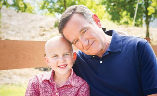 Robin Williams with St. Jude patient Darcy in 2013