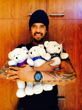 Michael Franti pictured with Three Little Bears in honor of being named Operation Smile's first San Francisco Universal Smile Award recipient.