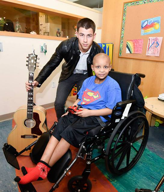 Nick Jonas With A Patient At Children's Hospital at Montefiore
