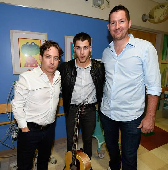 Charlie Walk EVP of Republic Records, Nick Jonas and Pete Griffin President of Musicians on Call