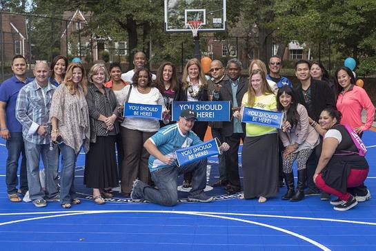 WorldVentures Foundation Executive Director Gwyneth Lloyd (center) is surrounded by WorldVentures Independent Representatives at the unveiling of Atlanta0s first DreamCourt