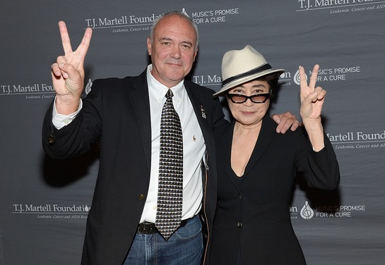 Yoko Ono Lennon poses on the red carpet with Hard Rock International President and CEO Hamish Dodds