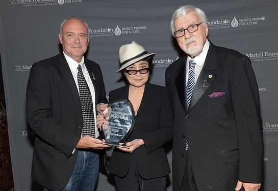 Hard Rock International President and CEO Hamish Dodds accepts the Spirit of Excellence Award from Yoko Ono Lennon
