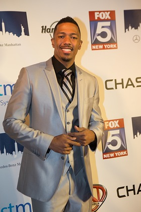 Nick Cannon poses on the red carpet at Hard Rock Cafe in Times Square during A Tribute to Nick Cannon