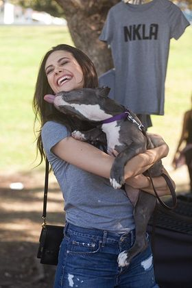 Emmy Rossum is smothered with kisses from an adorable pit pull puppy at the Best Friends NKLA Adoption Weekend